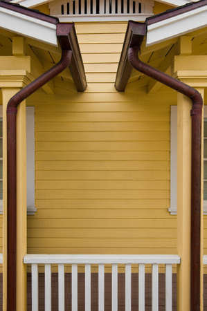Matched copper rain gutters on the porches of a duplex photo