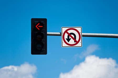 uturn: A left turn lane signal light and no u-turn sign. Stock Photo