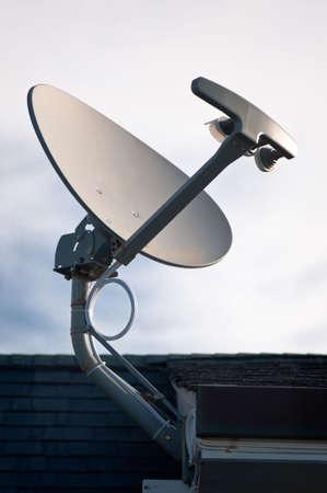 sattelite: A roof mounted sattelite television antenna