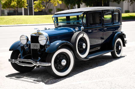 sedan: Deep blue 1930 classic vintage sedan.