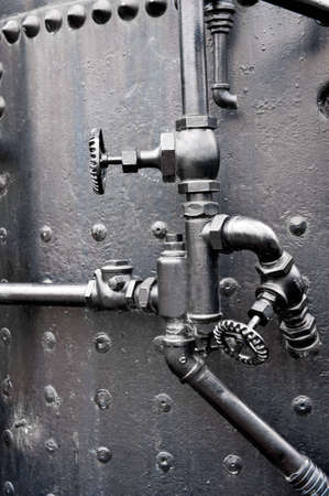 Control valves on the boiler of an old steam engine