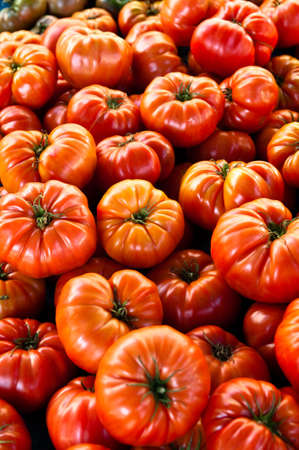 Shiny organic heirloom tomatoes in a farmers market photo