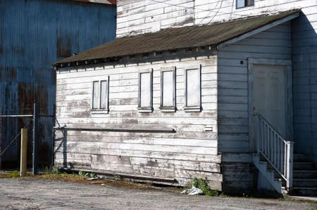 bedraggled: An old and dilapedated produce packing shed