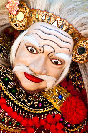 enact: Balinese dancer wearing the mask of the Old Man, Topeng Tua.