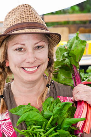 A farm woman in a hat posing for a photograph Stock Photo - 7587209