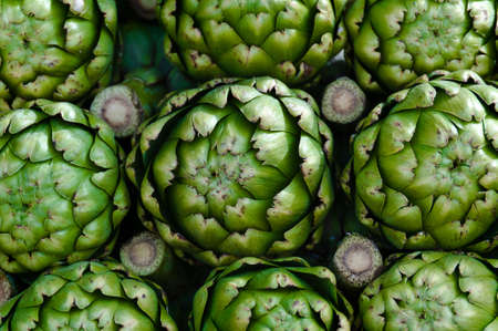 Piled artichokes in a vendor's stall at the farmers market Stock Photo - 8509641