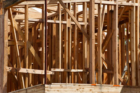 Wooden framing of an unfinished residential building. Stock Photo