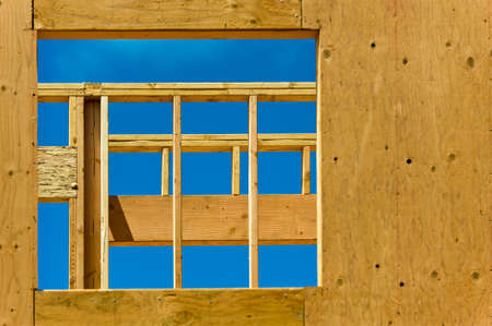 Looking through the opening for a window of an unfinished house. Stock Photo - 8509633