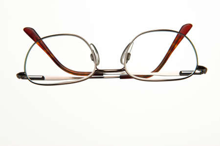 A pair of wire framed eyeglasses isolated on a white background