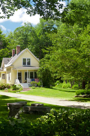 colonial house: A yellow country home in New Hampshire