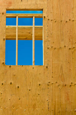 Looking through the opening for a window of an unfinished house. Stock Photo - 12337836