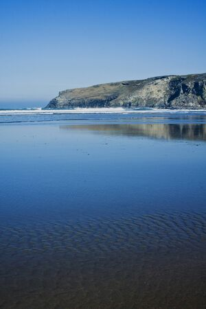 Penhallic point is at the far end of the beach at Trebarwith Strand photo