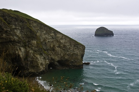 View from the cliff path of Dennis point and Gull Rock at Trebarwith Strand Cornwall UK photo