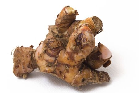 Natural galangal rhizomes in indonesia called lengkuas or laos are used in traditional asian cuisines, isolated on white background