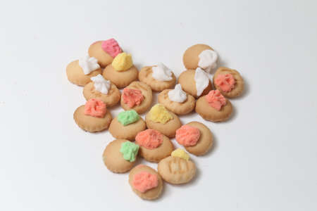 Belly button iced gem biscuits on white background