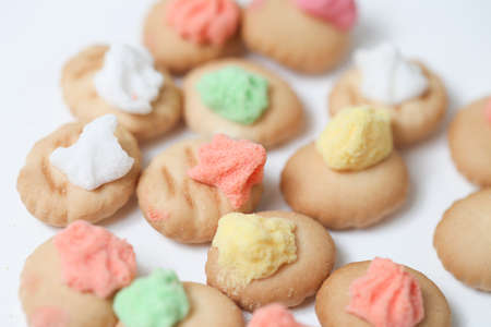 Belly button iced gem biscuits on white background Archivio Fotografico