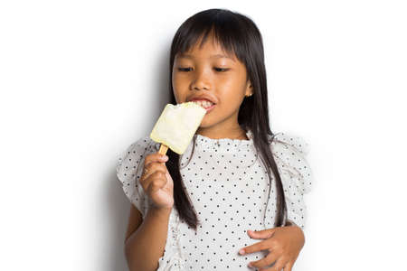 Happy asian little girl with ice cream on white background