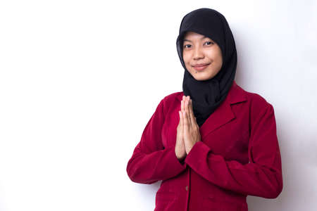 Asian Muslim woman welcoming guests gesture on white background