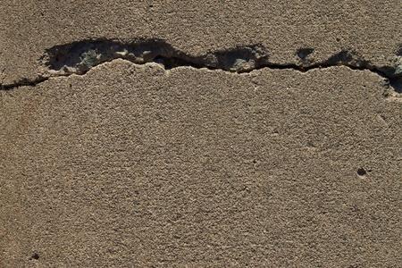 Crack in concrete background texture