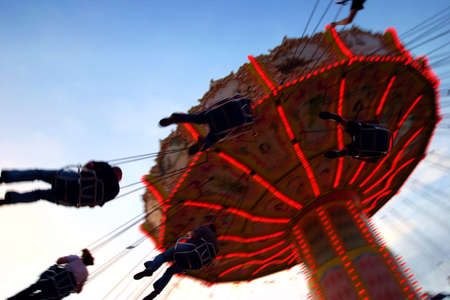 action photo of carousel - to have a ride on the merry-go-round in the dawn