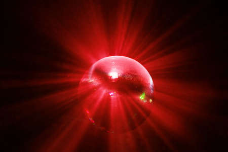 red shining discoball  mirrorball in motion Фото со стока