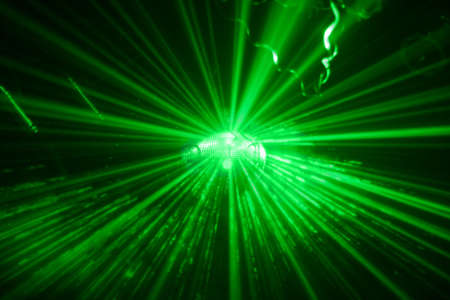 green shining disco ball in motion