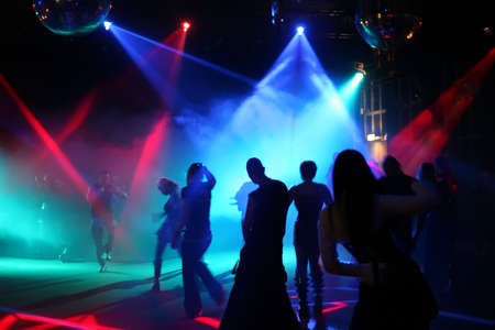 euphoria: Silhouettes of a dancing teenagers in a disco Stock Photo