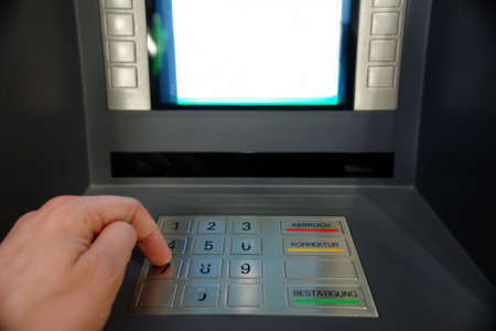 ATM Access - Males hand typing pin number Stock Photo - 983430