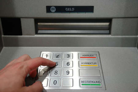 ATM Access - Males hand typing pin number Stock Photo - 983425