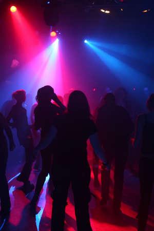beat women: Dancing people in an underground club