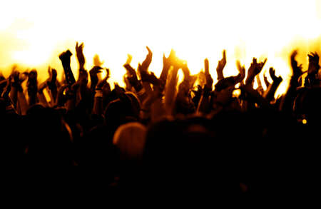 silhouettes of concert crowd in front of bright stage lights Stock Photo - 9954515