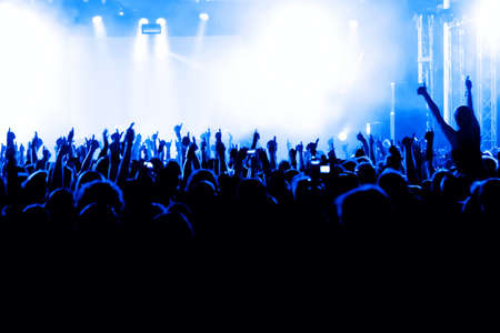 silhouettes of concert crowd in front of bright stage lights Stock fotó - 9954482