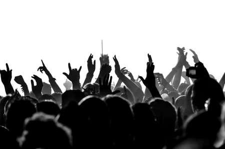 Silhuetas de multidão de concerto em frente a luzes de estágio brilhantes Foto de archivo - 27732846