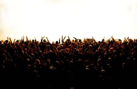 silhouettes of concert crowd in front of bright stage lights Reklamní fotografie