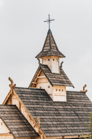 Part of Ancient wooden Slavic church. Historical and Architectural Museum in the open air. Kiev, Ukraine, Ancient park Kievskaya Rus.