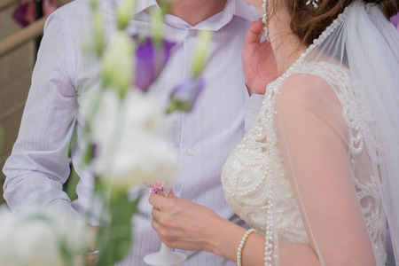 the groom with the bride and glasses in their hands in the restaurant