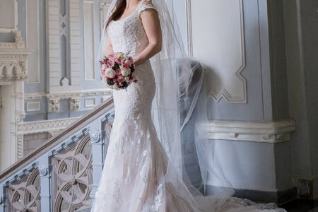 bride in vintage building on the stairs