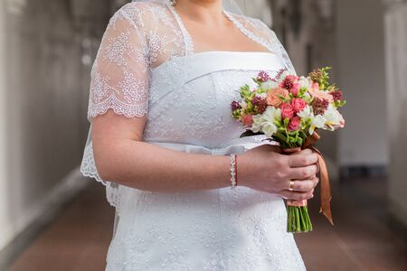 bride holds wedding bouquet in her hands Stock Photo