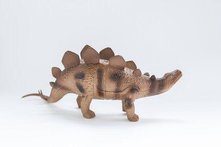 toy dinosaur on white background