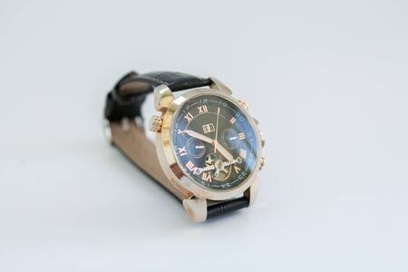 men's gold watch with leather strap