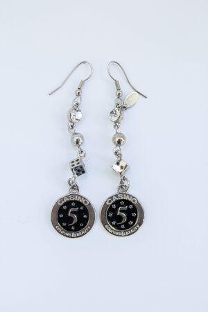 female earrings on white background Фото со стока