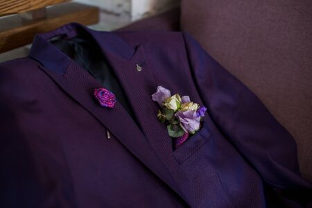 wedding suit of the groom on couch