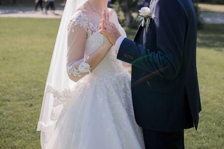 bride and groom cuddling together at wedding