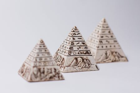 figurines of egyptian pyramids souvenir on white Reklamní fotografie