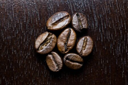 roasted coffee beans on wooden table