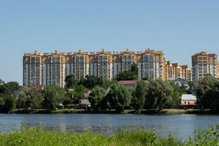 apartment building on background of blue sky Stock Photo