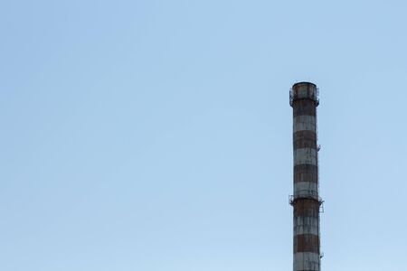 a factory chimney against blue sky Stock fotó