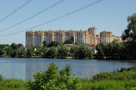 apartment building on a lake in park