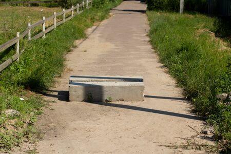 concrete blocking of dirt road Foto de archivo - 150127960
