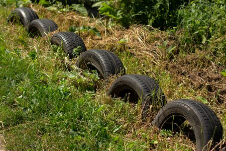 fence of old tires in garden
